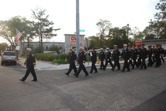 Chief Saetran leads firefighters to the 9/11 memorial services