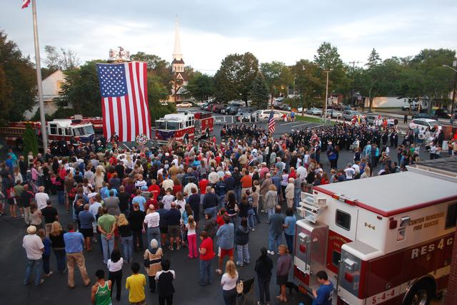 Residents fill the parking lot at CMFD