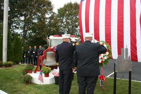 Asst Chiefs Primus & Kuzmech III place wreath at the memorial site