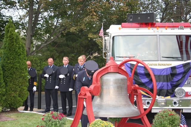 """Ex Captain Mike Whelan Strikes The Four Fives … A tradition where five bell strikes, repeated in four series, with a slight pause between each series. This symbolizes the rendering of final honors to departed comrades. This is known in the fire service as """"STRIKING THE FOUR FIVES""""."""