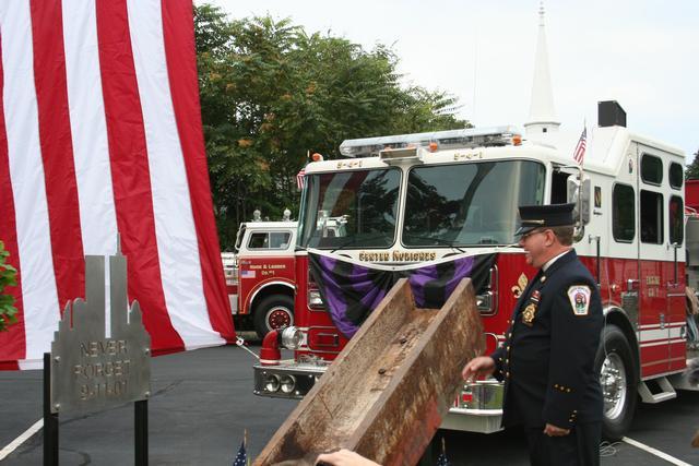 Department Chaplain John G. Fleischmann blessing the WTC Steel