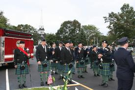 "The Siol Na Heireann bagpipes, filled the air with the sounds of ""Amazing Grace"" in a solemn tribute to those who died."